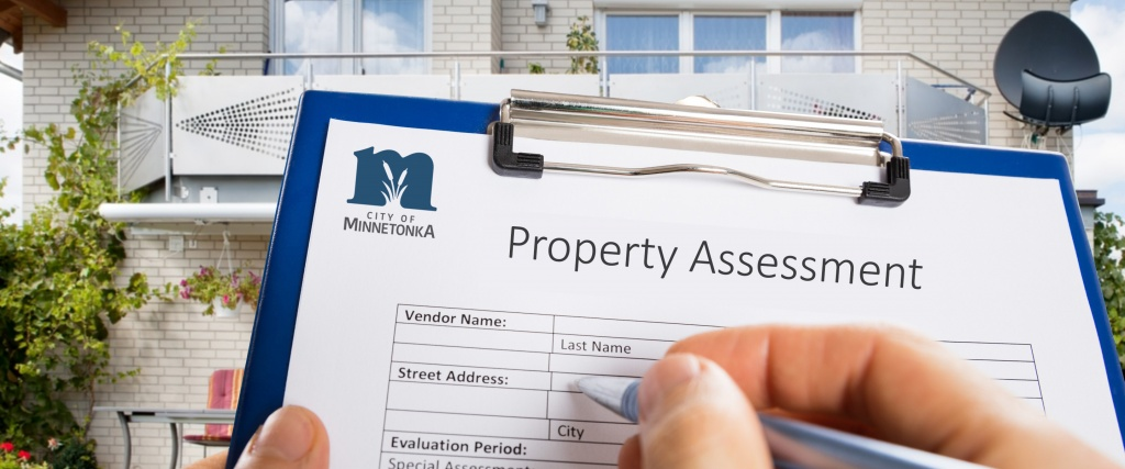 Someone filling out the property assessment form.