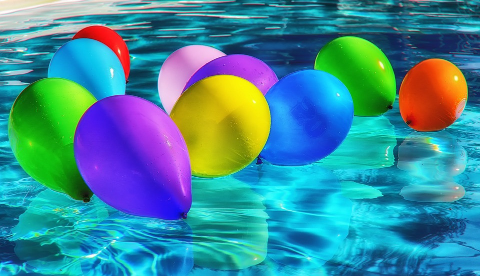 Balloons in a pool.